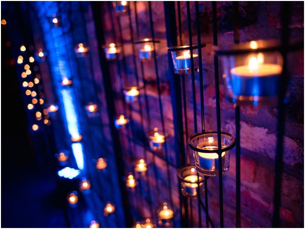 Candles on a Brick Wall