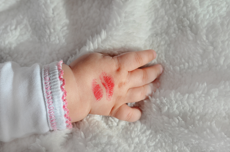 A Lipstick Kiss on a Baby's Hand