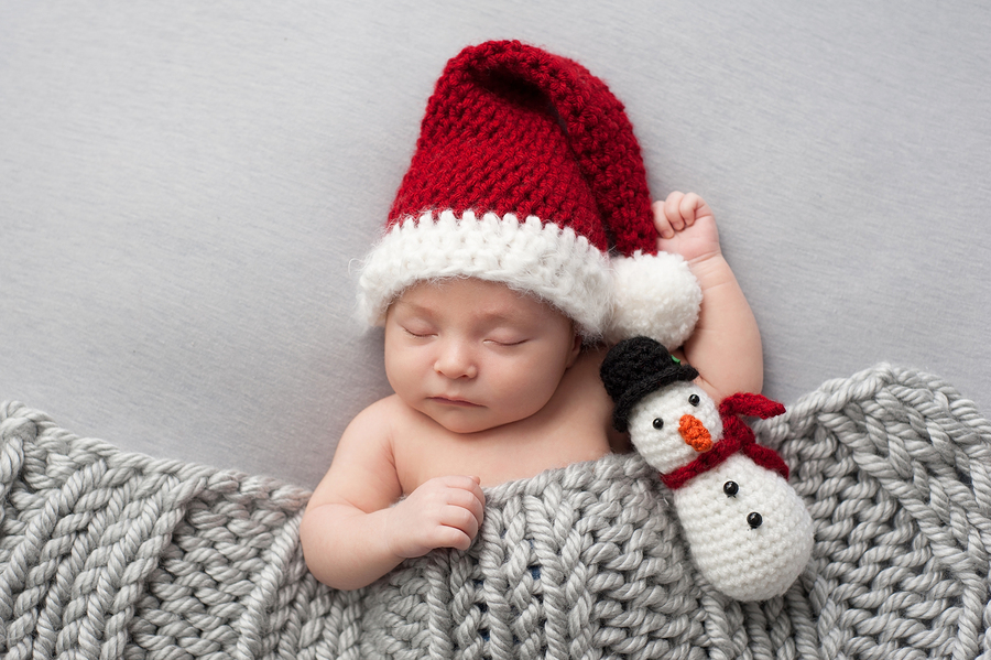 A Sleeping Baby in a Santa Claus Hat