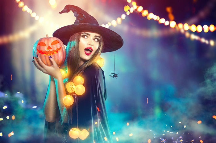 Halloween Witch with a Carved Pumpkin